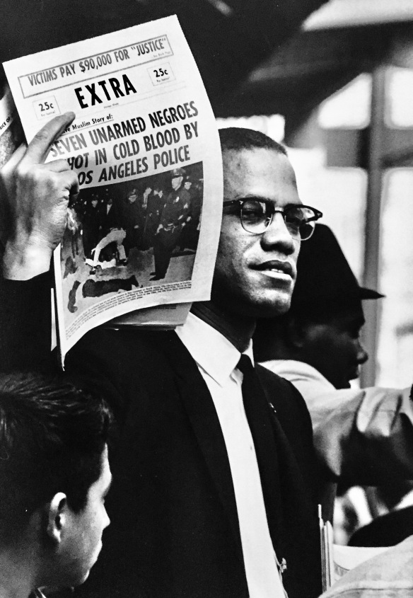 Gordon Parks Black muslims Malcolm X Holding Up Black Muslim Newspaper, Chicago, Illinois, 1963 (Gordon Parks -I am You- Selected works 1942-1978 @ Foam photography museum, Amsterdam)